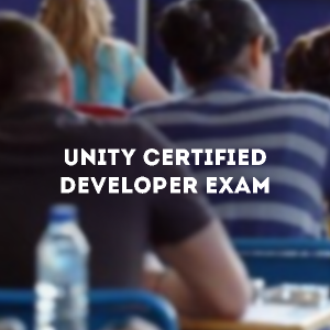 "A few people sit at desks facing away from the camera. The image is blurred for effect. On top, text reads ""Unity Certified Developer Exam"""